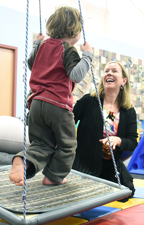 Dr. Jodi Morris enjoys some fun time with a youngster at the OSNS Child and Youth Development Centre this week where she was doing clinical evaluations for children and conducting the first in a series of workshops for parents. Mark Brett/Western News